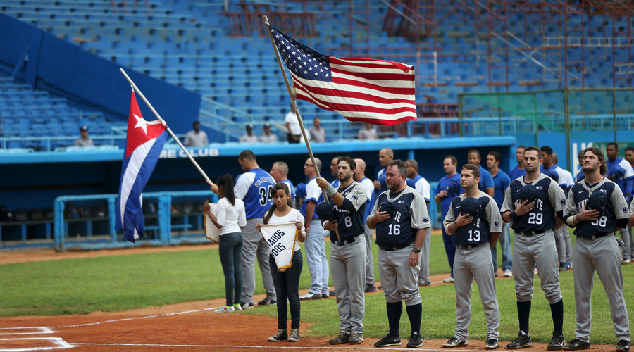 The U.S. Penn State baseball team and Cuba's Industriales perform a pre-game flag ceremony at the Latinoamericano stadium in Havana, November 23, 2015. © Alexandre Meneghini