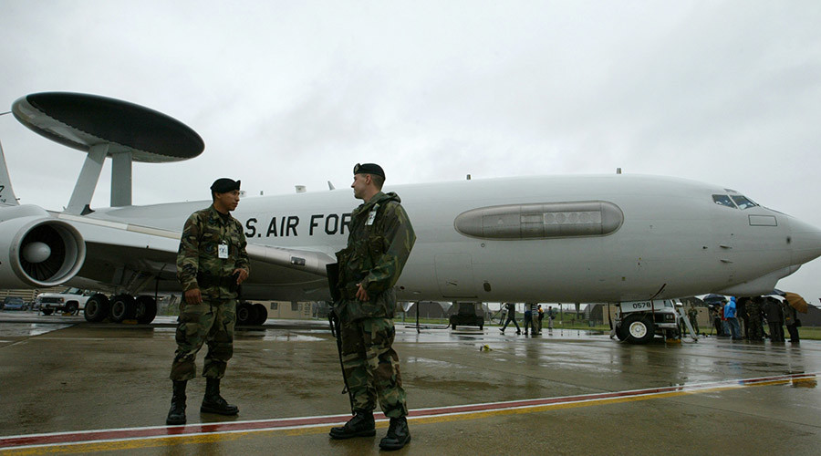 Soldiers stand guard in front of an E-3 Sentry AWACS aircraft © Reuters