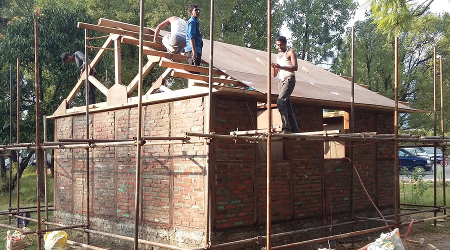 Nepal rebuilds with quake proof japanese designs rt news for Earthquake resistant home designs