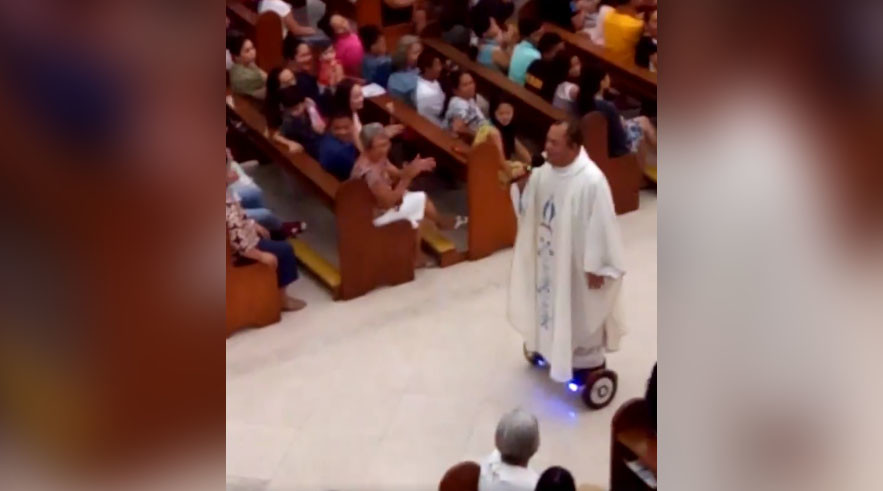 Filipino priest grounded by Church for gliding on hoverboard during mass (VIDEO)