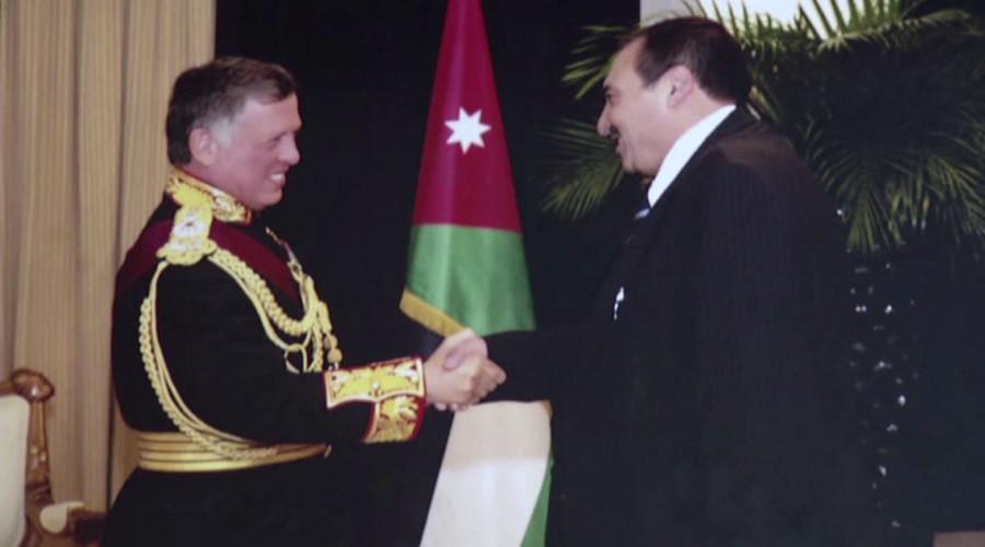 Mazen Dalaeen shakes hands with King of Jordan Abdullah II