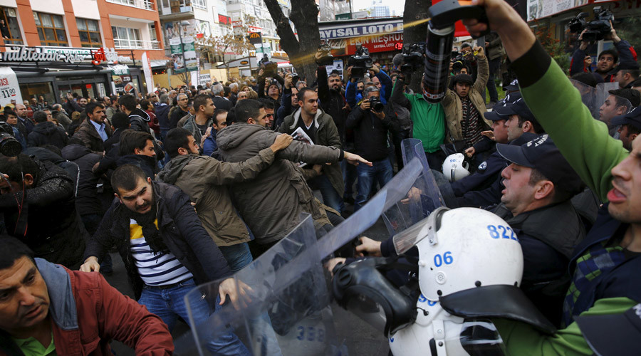 Police use tear-inducing agent against demonstrators during a protest over the arrest of journalists Can Dundar and Erdem Gul in Ankara, Turkey, November 27, 2015. © Umit Bektas