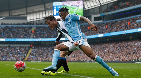 Manchester City's Raheem Sterling in action with Newcastle's Daryl Janmaat. City of Manchester Stadium 3/10/15 © Andrew Yates