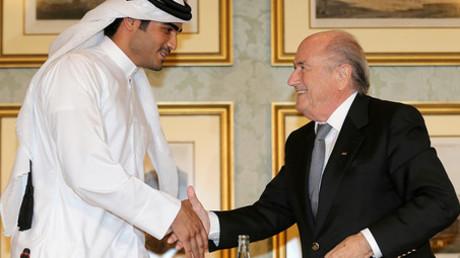 FIFA President Sepp Blatter (R) shakes hands with Qatar's 2022 World Cup Bid Chief Sheikh Mohammed Al-Thani (L) © Fadi Al-Assaad