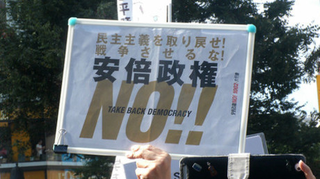 """We want the democracy back. Don't start the war. No to Abe politics.""© Derek Monroe"