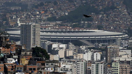 The Maracana stadium is seen between Turano slum (L) and Mangueira slum, in Rio de Janeiro, Brazil, November 19, 2015. © Sergio Moraes