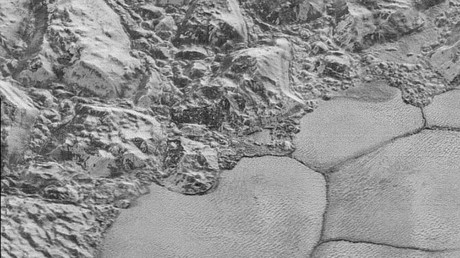 The Mountainous Shoreline of Sputnik Planum: In this highest-resolution image from NASA's New Horizons spacecraft, great blocks of Pluto's water-ice crust appear jammed together in the informally named al-Idrisi mountains. © NASA/JHUAPL/SwRI