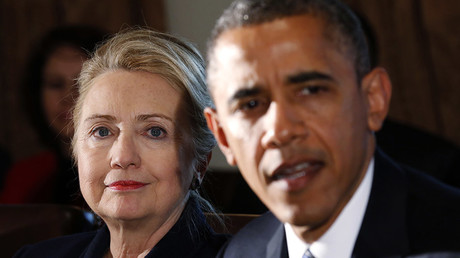 U.S. Secretary of State Hillary Clinton (L) listens to U.S. President Barack Obama. © Kevin Lamarque