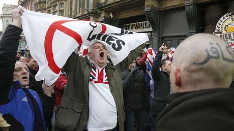 A man gestures during a demonstration by supporters of the Pegida movement in Newcastle, northern England, February 28, 2015. © Peter Nicholls