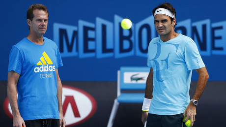 Switzerland's Roger Federer (R) attends a training session with his coach Stefan Edberg at the Rod Laver Arena in Melbourne Park January 18, 2015. © Issei Kato