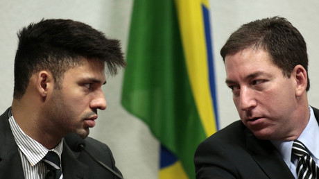 Glenn Greenwald (R), American journalist, speaks with partner David Miranda. © Ueslei Marcelino