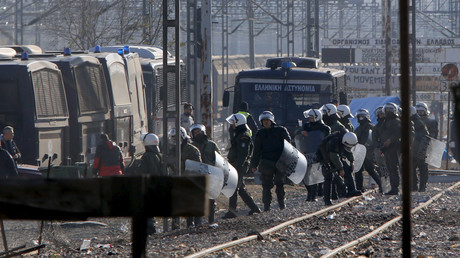 Greek police officers guard the perimeter where hundreds of migrants, who were stranded on the Greek-Macedonian border and blocking rail traffic, are gathered in tents after a police operation near the village of Idomeni, Greece, December 9, 2015. © Ognen Teofilovski