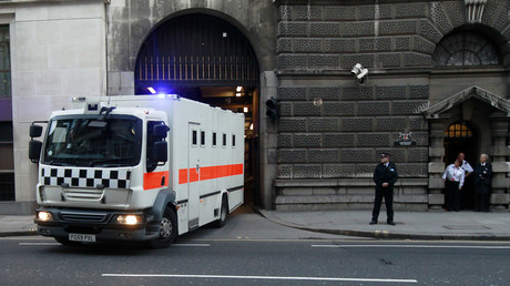 A prison van leaves under armed escort after the verdict in the Lee Rigby murder trial at the Old Bailey in central London, December 19, 2013. © Luke MacGregor