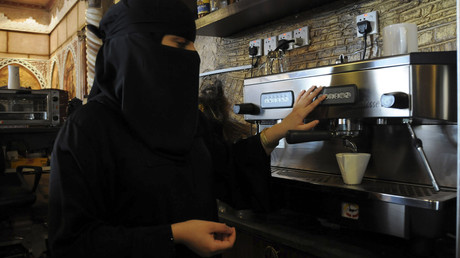 A veiled Saudi woman makes coffee as she works at a coffee shop in Tabuk, 1500 km (932 miles) from Riyadh November 30, 2013. © Mohamed Alhwaity
