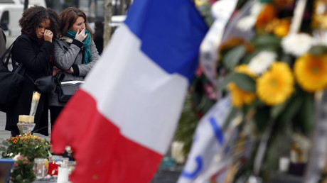 Two women cry as they pay tribute to the victims of Paris attacks at the Place de la Republique in Paris, France, November 27, 2015. © Eric Gaillard