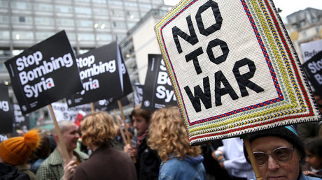 Protestors in London, Britain December 12, 2015 take part in a demonstration against bombing Syria. © Neil Hall
