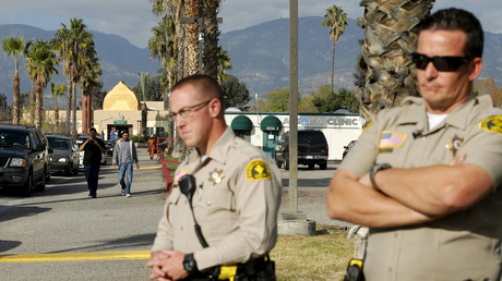 Police officers stand watch as people leave Friday prayers at the Dar Al Uloom Al Islamiyah-Amer mosque where shooting suspect Syed Rizwan Farook was seen two to three times a week at lunch time, in San Bernardino, California December 4, 2015. © Mike Blake