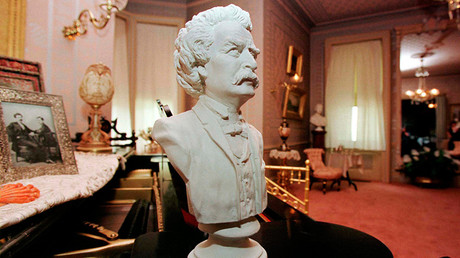 A bust of the author Mark Twain sits on a piano in the drawing room of The Mark Twain House in Hartford, where the writer wrote the novels