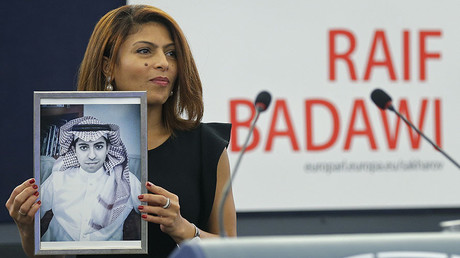 Ensaf Haidar, the wife of jailed Saudi Arabian blogger Raif Badawi, poses with a portrait of her husband as she receives the 2015 Sakharov Prize on his behalf during a ceremony at the European Parliament in Strasbourg, December 16, 2015. © Vincent Kessler