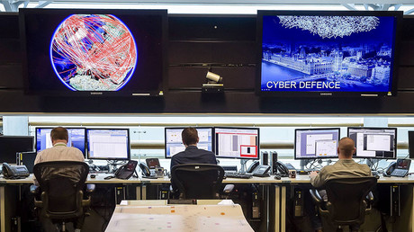 People sit at computers in the 24 hour Operations Room inside GCHQ, Cheltenham in Cheltenham. © Ben Birchall