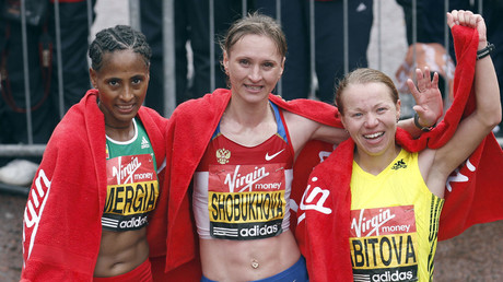 Liliya Shobukhova (C) of Russia celebrates winning the women's London marathon, with second placed Inga Abitova (R) of Russia and third placed Asefelech Mergia of Ethiopia, in London April 25, 2010. © Andrew Winning