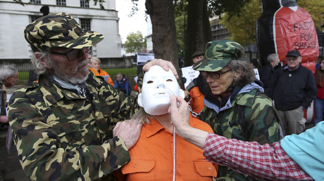 Supporters of Shaker Aamer, the last British prisoner at Guantanamo Bay, simulate a force feeding outside Downing street in central London, October 24, 2015. © Paul Hackett