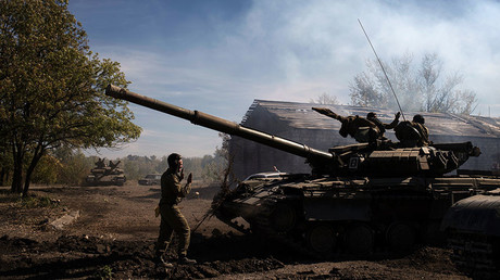 Self-defense fighters of the Luhansk People's Republic seen here during the withdrawal of weapons below 100mm caliber from the contact line in the self-proclaimed Luhansk People's Republic. © Valeriy Melnikov