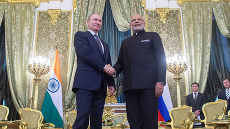 December 24, 2015. Russian President Vladimir Putin, left, and Indian Prime Minister Narendra Modi meet in the Kremlin. © Sergey Guneev