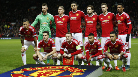 Manchester United players pose for a team group photo before the match. © Carl Recine