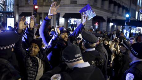 Demonstrators confront police officers during a protest in reaction to the fatal shooting of Laquan McDonald in Chicago, Illinois, November 27, 2015.