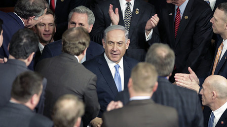 Israeli Prime Minister Benjamin Netanyahu (C) arrives in the House Chamber prior to his address to a joint meeting of Congress ion Capitol Hill in Washington, March 3, 2015. © Joshua Roberts