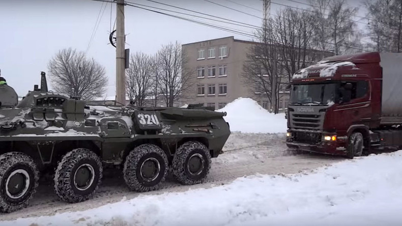Snow job: Russian army tows 18-wheeler stuck in blizzard — RT News