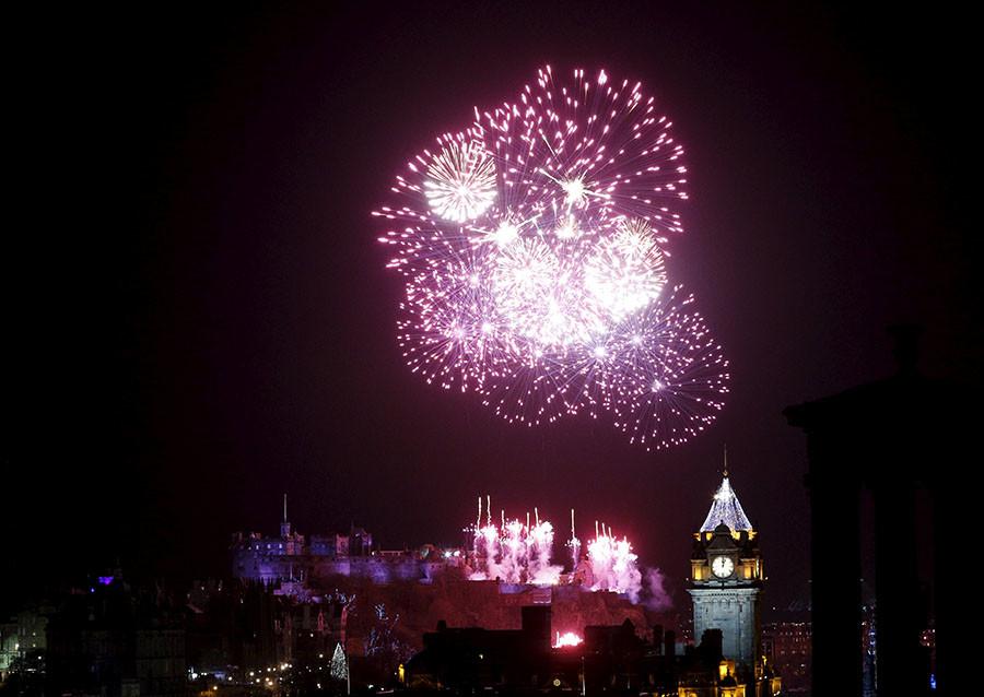 Fireworks explode over the castle in Edinburgh, Scotland, January 1, 2016. ©Russell Cheyne