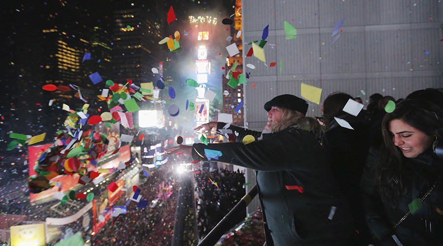 Revelers throw confetti from a balcony to celebrate during New Year festivities above Times Square in New York January 1, 2016. © Lucas Jackson
