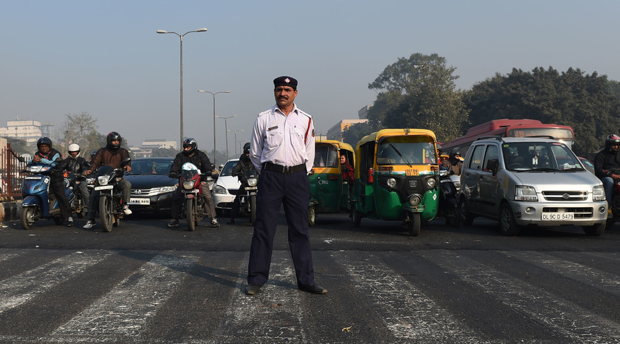 An India traffic policeman stands at a traffic intersection in New Delhi on December 31, 2015. © Money Sharma