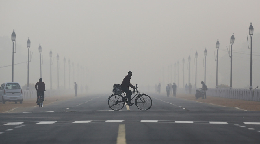 A newspaper vendor rides his bicycle on a smoggy morning in New Delhi, India. © Anindito Mukherjee