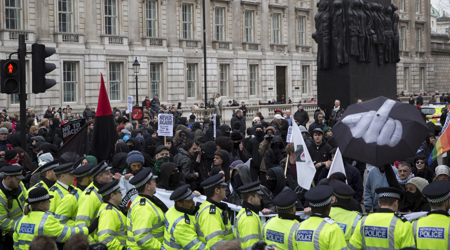 A protester clashes with police as anti-fascist demonstrators stage a counter demonstration during a PEGIDA (Patriotic Europeans Against the Islamisation of the West) rally on Whitehall in central London © Neil Hall