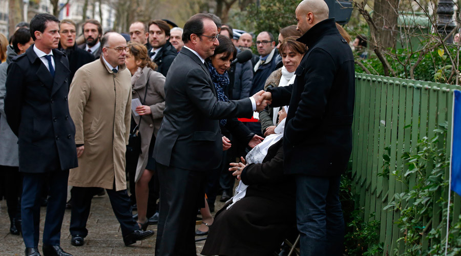 French President Francois Hollande (C) greets the mother and the family of Ahmed Merabet, the policeman who was killed during the last year's January attack, during a ceremony to unveil a commemorative plaque at the site in Paris, France, January 5, 2016. © Benoit Tessier