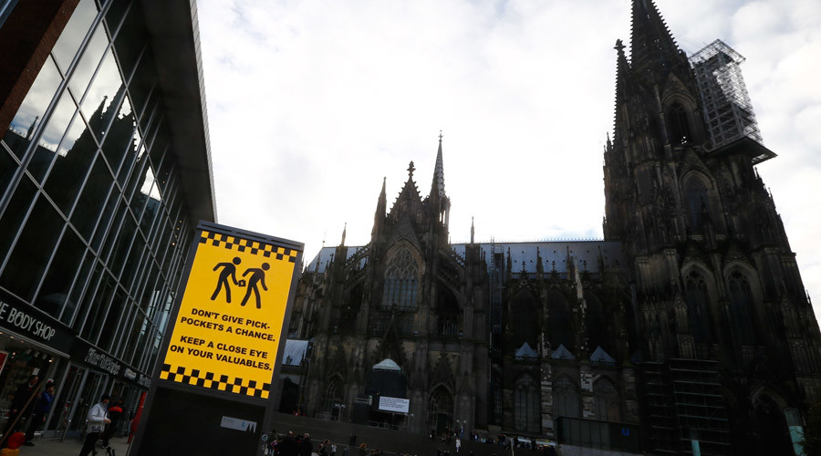 An electronic information sign warning the general public against pickpockets, is displayed on an advertising board outside the main railway station and in front of Cologne Cathedral in Cologne, Germany, January 5, 2016. © Wolfgang Rattay