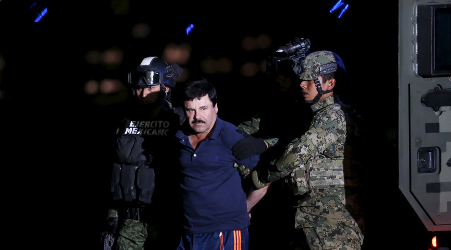 "Joaquin ""El Chapo"" Guzman is escorted by soldiers during a presentation at the hangar belonging to the office of the Attorney General in Mexico City, Mexico January 8, 2016. © Edgard Garrido"