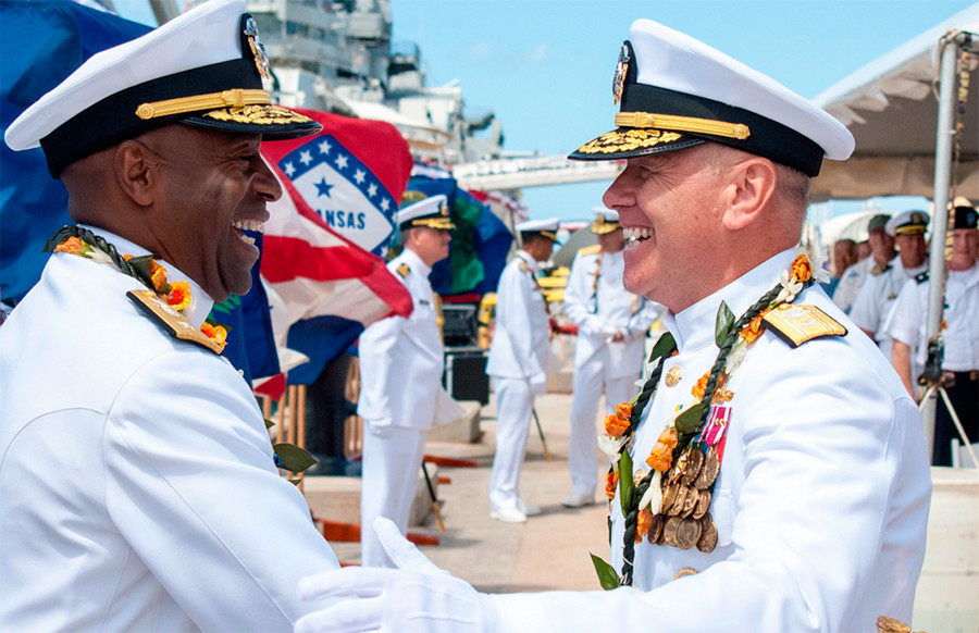 Rear Adm. Frank L. Ponds, left, shakes hands with Rear Adm. Richard L. Wiliams Jr., commander of Navy Region Hawaii and Naval Surface Group Middle Pacific © U.S. Navy photo by Mass Communication Specialist Seaman Johans Chavarro / public.navy.mil