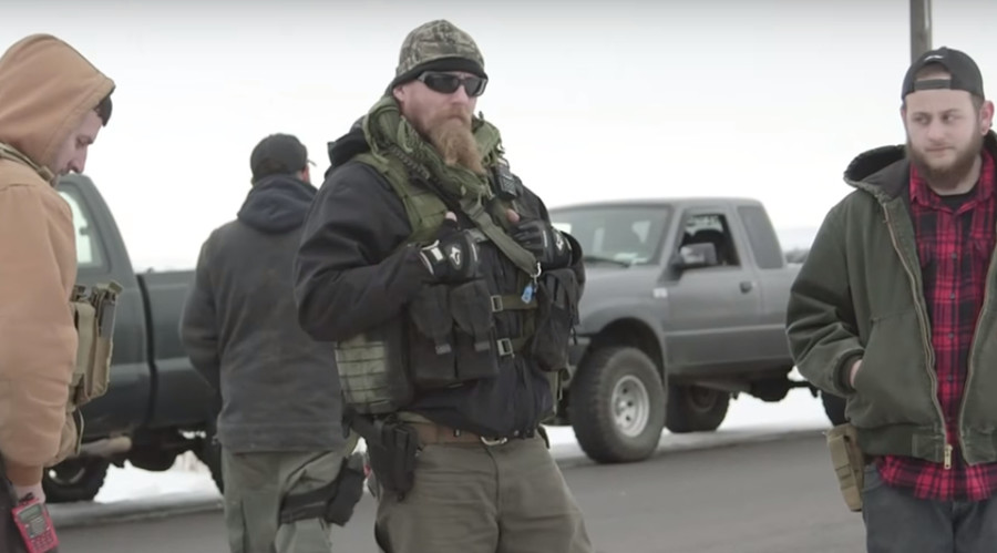 Oregon refuge occupiers dismiss armed supporters, start negotiating with FBI