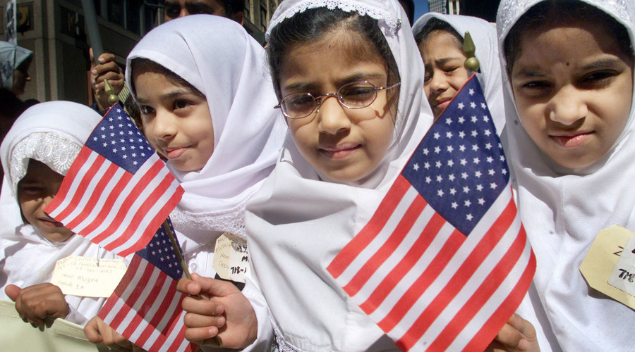 A group of young Muslim girls carry American flags during the 14 annual