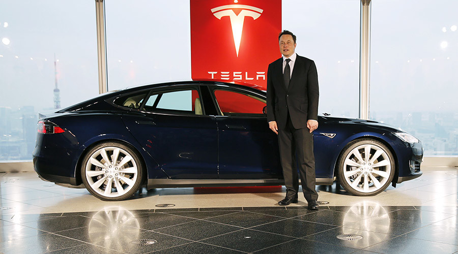 Tesla Motors Inc Chief Executive Musk poses with a Tesla Model S electric car © Toru Hanai