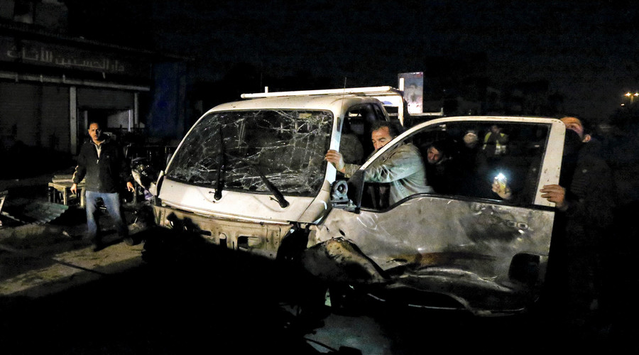 A man pushes his damaged car away from the site of a car bomb attack in New Baghdad, January 11, 2016. © Ahmed Saad