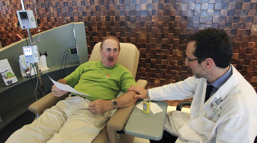 Dr. Antoni Ribas speaks with cancer patient during a promising cancer treatment clinical trial. © David McNew