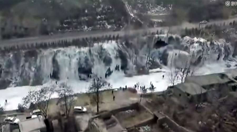 Elsa's dream: Frozen waterfall the width of football pitch captured in China (VIDEO)