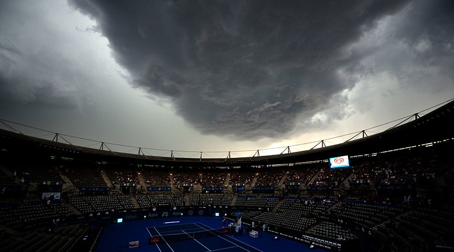 Storm clouds gather over centre court as play is suspended during the Sydney International tennis tournament in Sydney on January 14, 2016. © Peter Parks