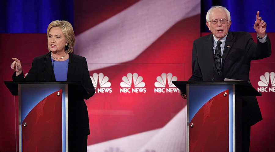 Democratic U.S. presidential candidate and former Secretary of State Hillary Clinton and rival candidate U.S. Senator Bernie Sanders speak simultaneously at the NBC News - YouTube Democratic presidential candidates debate in Charleston, South Carolina January 17, 2016. ©Randall Hill