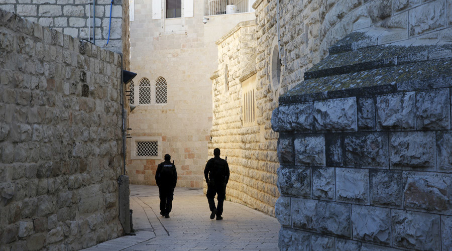 Israeli policemen walk near the Dormition Abbey on Mount Zion in Jerusalem's Old City, after graffiti was found on some of it's exteriors January 17, 2016. © Ronen Zvulun